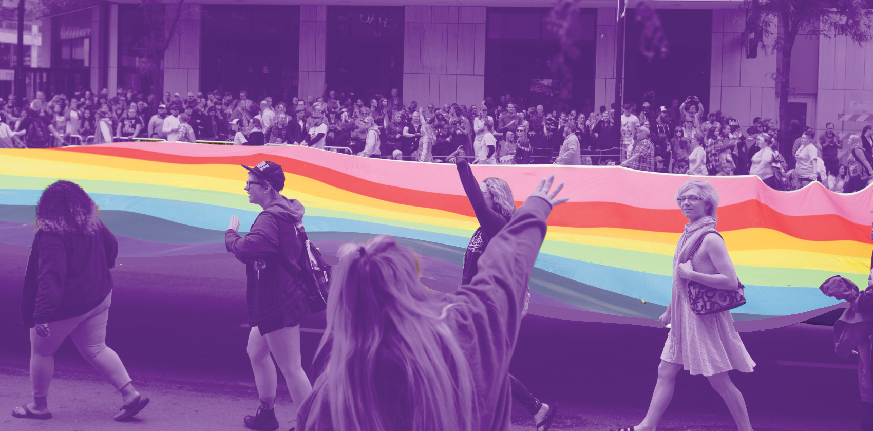 Give OUT Day - Pride Parade, rainbow banner and people walking