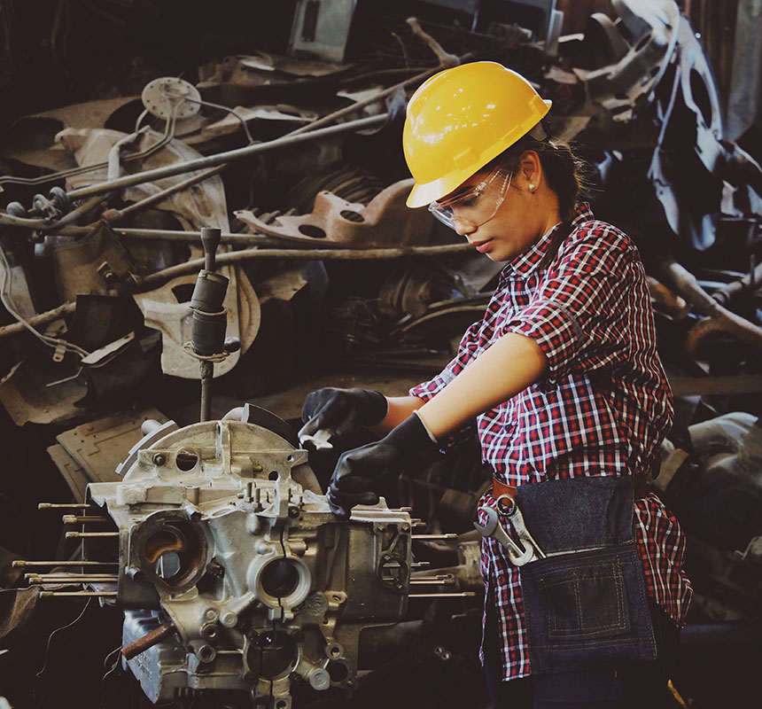 Machinist working on fixing an engine