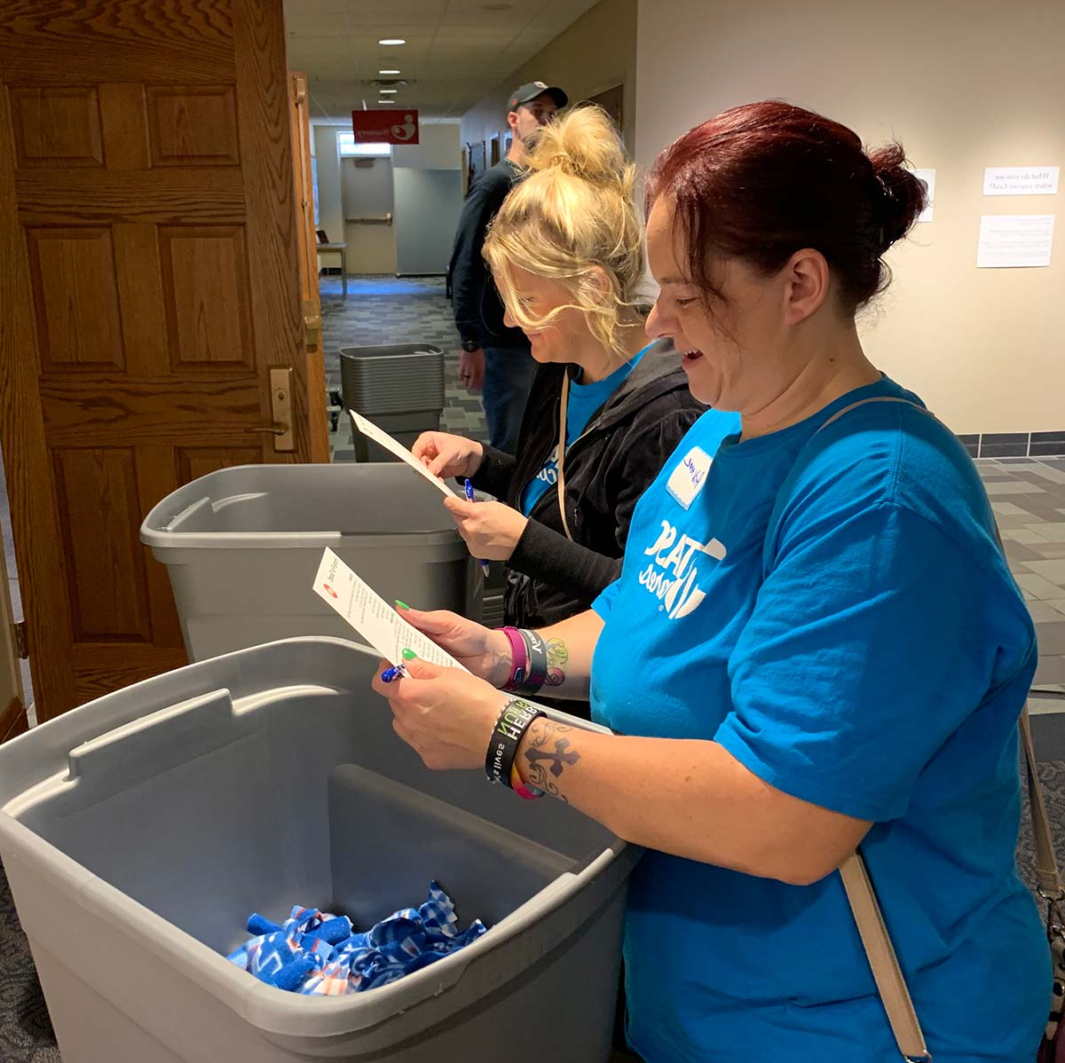 Volunteers pack kits at Home For Good in Minneapolis