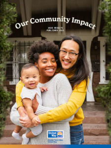 Our Community Impact - Image with a family enjoying the day under the trees