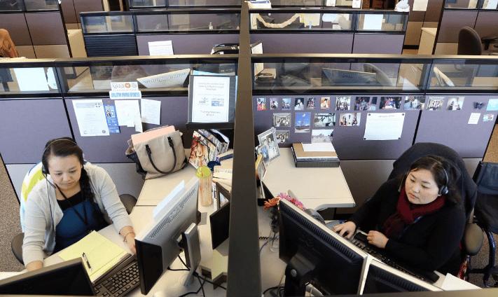 211 Helpline staff assisting callers